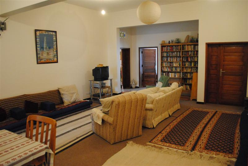 The Central Living Room In Residence Section Upstairs Of AIYS Featuring Bookshelves Against Wall Plenty Seating And A Television